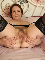 Mature hairy Tiffani exposes hanging breasts