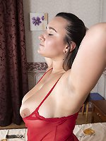Ramira poses in her red lingerie in bed