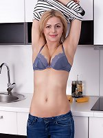 Ayda feels horny and strips naked in her kitchen